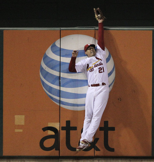 St. Louis Cardinals' Allen Craig catches a fly ball off the bat of Texas Rangers' Nelson Cruz during the sixth inning of Game 7 of baseball's World Series Friday, Oct. 28, 2011, in St. Louis. (AP Photo/Charlie Riedel)