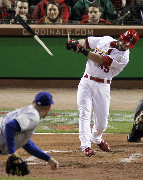 St. Louis Cardinals' Skip Schumaker breaks his bat as he grounds out from a pitch by Texas Rangers' Matt Harrison during the fourth inning of Game 7 of baseball's World Series, Friday, Oct. 28, 2011, in St. Louis. (AP Photo/Jeff Roberson)