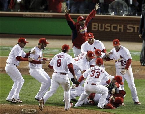 St. Louis Cardinals react after beating the Texas Rangers 6-2 at Game 7 of baseball's World Series Friday, Oct. 28, 2011, in St. Louis. The Cardinals win the series 4-3. (AP Photo/Jeff Roberson)