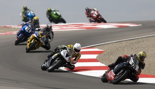 AMA Formula Xtreme Series racers lean through the