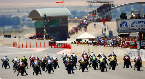 Tooele, UT--6/18/06--3:38:05 PM-   Racers line up at the start of the AMA Superbike Championship presented by Parts Unlimited at Larry Miller's Motorsports Park.  ***** This is Day 3 of three days of super bike racing at Larry Miller's Motorsports Park, which is in its first weekend of racing operation. There are two races this afternoon of note this afternoon:  3:00pm AMA Superbike Championship presented by Parts Unlimited Race 2 (100k - 21 laps)   Chris Detrick File #_1CD5705