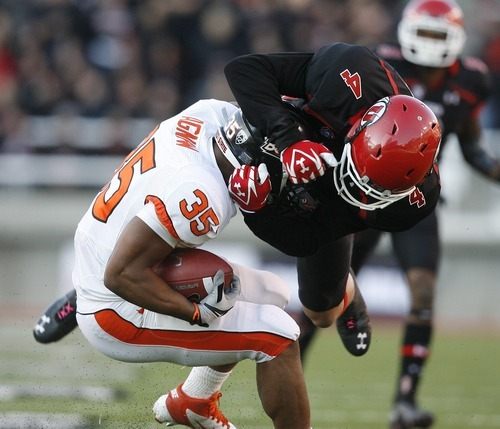 Chris Detrick  |  The Salt Lake Tribune Utah Utes linebacker Brian Blechen (4) tackles Oregon State Beavers running back Malcolm Agnew (35) during the first half of the game at Rice-Eccles Stadium Saturday October 29, 2011. Utah is winning 24-0. Blechen was called for a personal foul on this play.