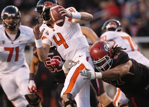 Chris Detrick  |  The Salt Lake Tribune Oregon State Beavers quarterback Sean Mannion (4) is sacked by Utah Utes defensive lineman Tevita Finau (97) during the first half of the game at Rice-Eccles Stadium Saturday October 29, 2011. Utah is winning 24-0.