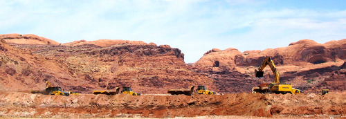JUDY FAHYS  |  The Salt Lake Tribune The massive pile of uranium tailings at the old Atlas site near Moab has been shrinking. Some 4 million tons already have been shipped off by train, but another 12 million tons remain. Federal funding reductions will mean a slowdown in the work.