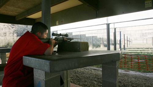Steve Griffin     The Salt Lake Tribune Dominik Valdez, 15, shoots a rifle at the Lee Kay Center in Salt Lake City on Wednesday. Dominik was at the range with his father, Richard Valdez.