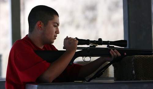 Steve Griffin     The Salt Lake Tribune Dominik Valdez, 15, ejects a round from his rifle as he shoots at the Lee Kay Center in Salt Lake City. Dominik was at the range with his father, Richard Valdez.