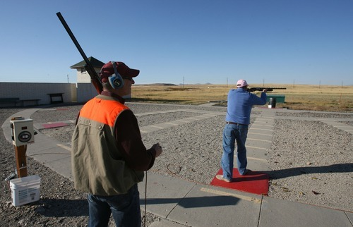 Steve Griffin     The Salt Lake Tribune Brothers Michael and Jeff Wolfe shoot clay pigeons at the Lee Kay Center in Salt Lake City in preparation for an upcoming trip to South Dakota to hunt pheasants.