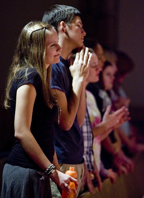 Djamila Grossman  |  The Salt Lake Tribune  Chandra Tvedtnes, 21, and Paul Burgess, 19, watch and pray as a band plays at The Mount, a service for young adults at Mount Olympus Presbyterian Church on the Salt Lake Valley's east bench on Sunday, Oct. 23, 2011.