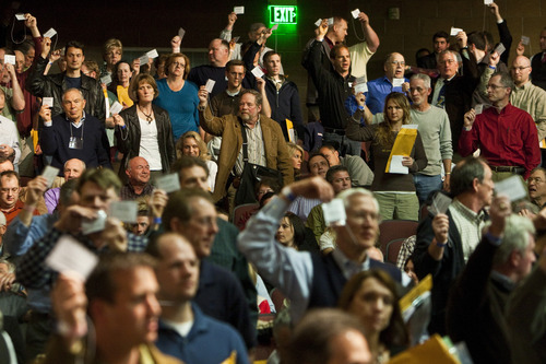 Photo by Chris Detrick | The Salt Lake Tribune  Delegates vote in favor of a resolution seeking to repeal a guest worker immigration bill during the annual Utah County Republican Party convention at Maple Mountain High School  Saturday April 30, 2011.  A resolution seeking to repeal a guest worker immigration bill signed by the governor earlier this year passed narrowly at the Utah County Republican Organizing Convention.