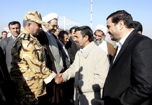In this image provided by the Presidency Office, Iranian President Mahmoud Ahmadinejad, second right, shakes hand with an unidentified army colonel as he arrives at the Shahr-e-Kord, during his provincial tour, in central Iran, Wednesday, Nov. 9, 2011. Iran won't retreat