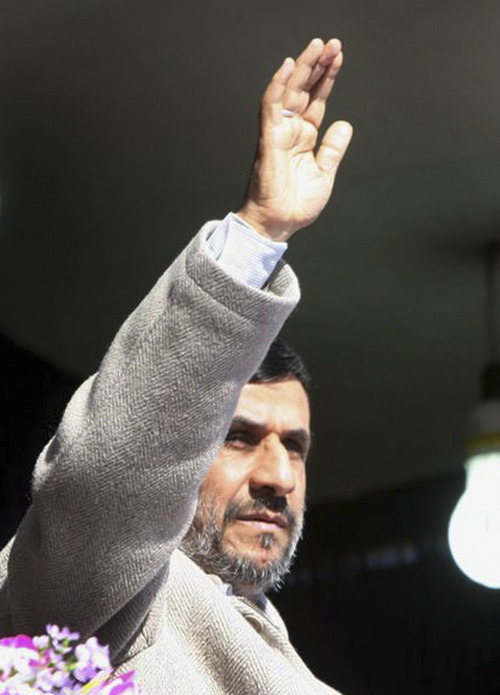 In this image provided by the Presidency Office, Iranian President Mahmoud Ahmadinejad, waves to the crowd during a public gathering at the city of Shahr-e-Kord, in his provincial tour, in central Iran, Wednesday, Nov. 9, 2011. Iran won't retreat