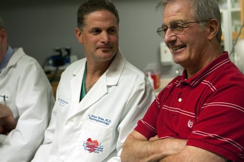 Chris Detrick  |  The Salt Lake Tribune Heart rhythm specialist Peter Weiss, M.D., and Stephen Summerill talk about Sumerill's heart procedure at Intermountain Medical Center on Wednesday.
