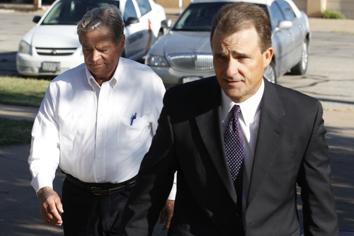 Fredrick Merril Jessop, left, walks to the Coke County Court House in Robert Lee, Texas, Tuesday, Nov. 1, 2011 to start the first day of testimony of his trial. Jessop, 75, is a former bishop of the polygamist Fundamentalist Church of Jesus Christ of Latter Day Saints. He is is accused of marrying an underage girl to group leader Warren Jeffs in 2006.  (AP Photo/San Angelo Standard-Times, Patrick Dove)
