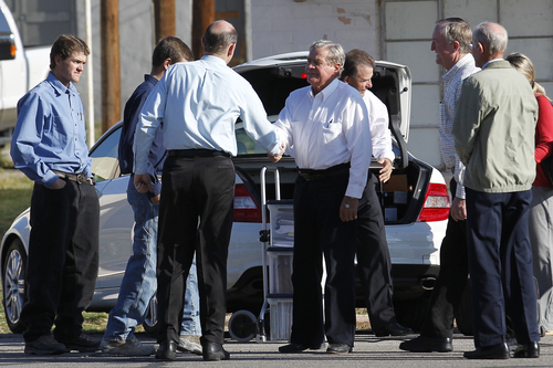 Fredrick Merril Jessop, center, greets fellow Fundamentalist Church of Jesus Christ of Latter Day Saints members before heading into the Coke County Court House for his trial Tuesday, Nov. 1, 2011 in Robert Lee, Texas. Jessop, 75, is a former bishop of the polygamist Fundamentalist Church of Jesus Christ of Latter Day Saints. He is accused of marrying an underage girl to group leader Warren Jeffs in 2006.  (AP Photo/San Angelo Standard-Times, Patrick Dove)