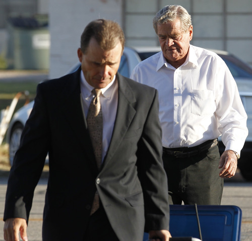 Led in by attorney Rae Leifeste, Fredrick Merril Jessop, a former leader of the Fundamentalist Church of Jesus Christ of Latter-Day Saints, walks to the Coke County Courthouse Monday, Oct. 31, 2011 to start the jury selection phase of his trial. Jessop is charged with performing a ceremony prohibited by law, a third-degree felony punishable by two to 10 years in prison and a fine up to $10,000. (AP Photo/San Angelo Standard-Times, Patrick Dove)