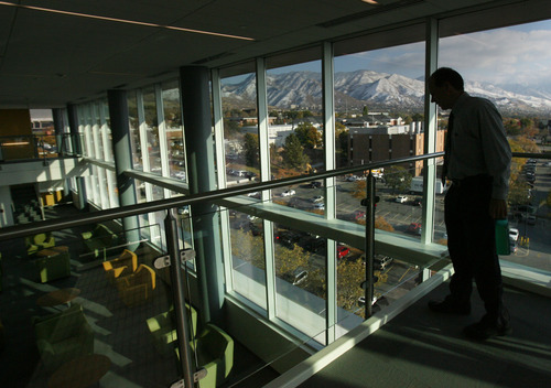 Kim Raff |  The Salt Lake Tribune Executive Career Coach Michael M. deLisser looks over the newly contructed research center that looks over the Wasatch Mountains in the Spencer Fox Eccles Business Buliding on the University of Utah's campus in Salt Lake City, UT on November 8, 2011.