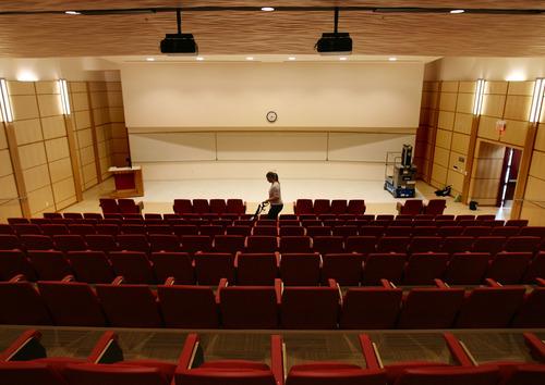 Kim Raff |  The Salt Lake Tribune Debi (cq) Smith vacuums the Eccles Auditorium in the Spencer Fox Eccles Business Building on the University of Utah's campus in Salt Lake City, UT on November 8, 2011.