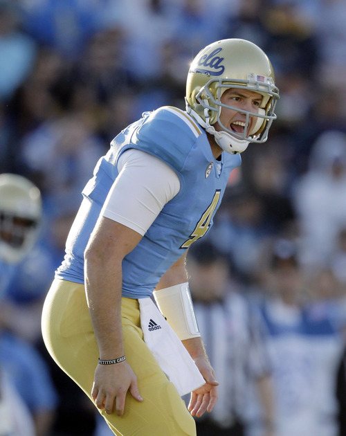 UCLA quarterback Kevin Prince calls a play during the first half of an NCAA college football game against Arizona State at the Rose Bowl in Pasadena, Calif., Saturday, Nov. 5, 2011. UCLA won 29-28. (AP Photo/Jae C. Hong)