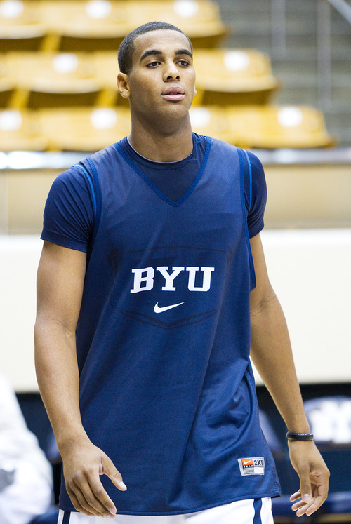 Brandon Davies looks on before talking to the media about his return to playing basketball for BYU at the Marriott Center, Tuesday, Nov. 8, 2011, in Provo, Utah. (AP Photo/The Daily Herald, Spenser Heaps)