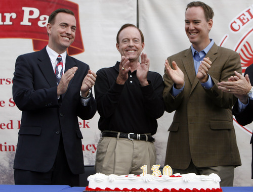 Francisco Kjolseth  |  The Salt Lake Tribune file photo  West Valley City Mayor Mike Winder, left, joins his father, Kent Winder, and Mike Dutton, president and CEO of Winder Dairy, to celebrate one of Utah's oldest companies. Mike Winder has acknowledged writing articles about his own city for the Deseret News and other media outlets under a pen name without the paper's knowledge.