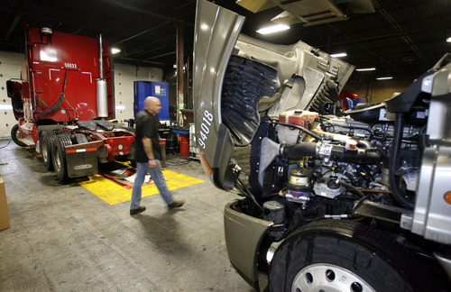 Steve Griffin     Tribune file photo Freightliner trucks get serviced in the England trucking garage in 2009. Dan England, chairman of C.R. England Inc., has been elected chairman of the American Trucking Associations for a one-year term.