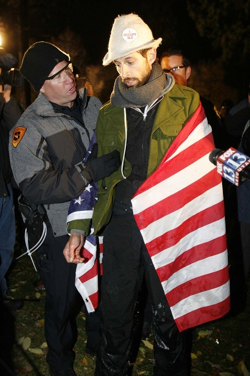 Trent Nelson  |  The Salt Lake Tribune Activist Jesse Fruhwirth is arrest by Salt Lake City police as they cleared the Occupy Salt Lake tent city from Pioneer Park in Salt Lake City, Utah, Saturday, November 12, 2011.