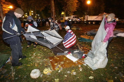 Trent Nelson  |  The Salt Lake Tribune Activists dismantle a tent as Salt Lake City police cleared the Occupy Salt Lake tent city from Pioneer Park in Salt Lake City, Utah, Saturday, November 12, 2011.