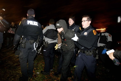 Trent Nelson  |  The Salt Lake Tribune An activist is arrested by Salt Lake City police, who cleared the Occupy Salt Lake tent city from Pioneer Park in Salt Lake City, Utah, Saturday, November 12, 2011.
