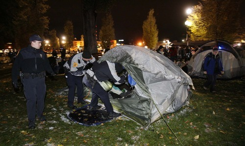 Trent Nelson  |  The Salt Lake Tribune Salt Lake City police searched tents as they cleared the Occupy Salt Lake tent city from Pioneer Park in Salt Lake City, Utah, Saturday, November 12, 2011.