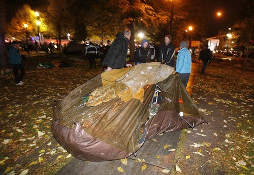 Trent Nelson  |  The Salt Lake Tribune Activists drag a tent away as Salt Lake City police cleared the Occupy Salt Lake tent city from Pioneer Park in Salt Lake City, Utah, Saturday, November 12, 2011.