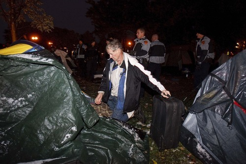 Trent Nelson  |  The Salt Lake Tribune A man packs up his tent and belongs as Salt Lake City police cleared the Occupy Salt Lake tent city from Pioneer Park in Salt Lake City, Utah, Saturday, November 12, 2011.