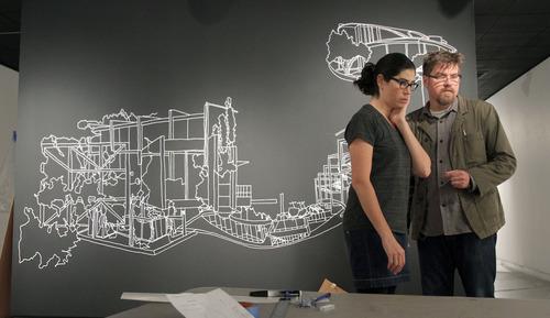 Francisco Kjolseth  |  The Salt Lake Tribune Artist Kim Schoenstadt ponders one of her pieces being created alongside her husband Jon Furmanski as she hangs her latest exhibit at the Salt Lake Art Center for emerging artists on Tuesday, Nov. 2, 2011.