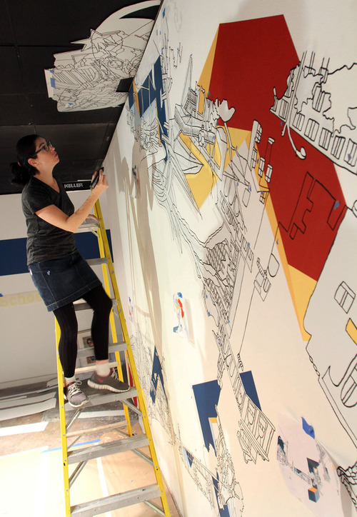 Francisco Kjolseth  |  The Salt Lake Tribune Artist Kim Schoenstadt, recipient of the Catherine Doctorow Prize for Contemporary Painting from the Salt Lake Art Center for emerging artists, works on one of her large installation pieces on Tuesday, Nov. 2, 2011. Her art combines architecture drawings and painting and is site-specific, with scenes from Salt lake City incorporated into them. Her works cover entire walls of the gallery.