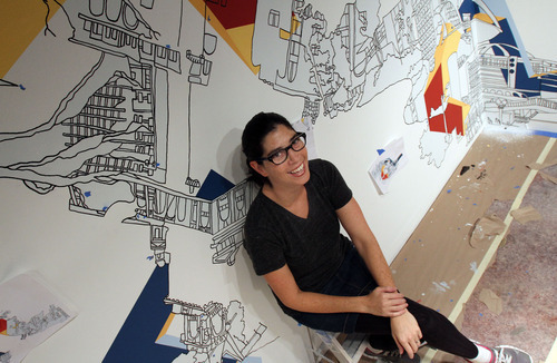 Francisco Kjolseth  |  The Salt Lake Tribune Artist Kim Schoenstadt, recipient of the Catherine Doctorow Prize for Contemporary Painting from the Salt Lake Art Center for emerging artists, takes a break from putting up her installation on Tuesday, Nov. 2, 2011. Her art combines architecture drawings and painting and is site-specific, with scenes from Salt lake City incorporated into them. Her works cover entire walls of the gallery.