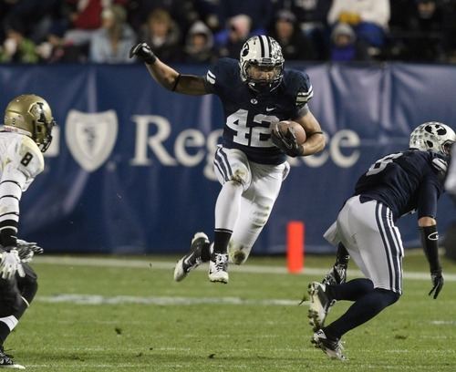 Rick Egan  | The Salt Lake Tribune   Brigham Young Cougars running back Michael Alisa (42) runs the ball, jn football action, BYU vs. the  Idaho Vandals football game at Lavell Edwards Stadium Saturday.