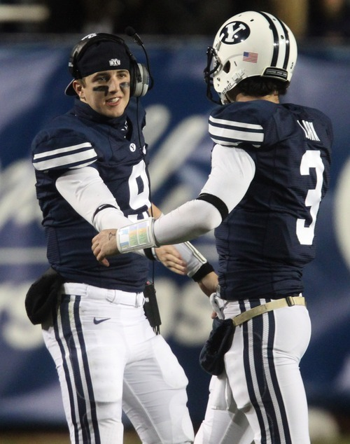 Rick Egan    The Salt Lake Tribune   Brigham Young Cougars quarterback Jake Heaps (9) shakes hands with quarterback James Lark (3) with BYU ahead 42-6, in football action, BYU vs. the Idaho Vandals football game at Lavell Edwards Stadium, Saturday, November 12, 2011.