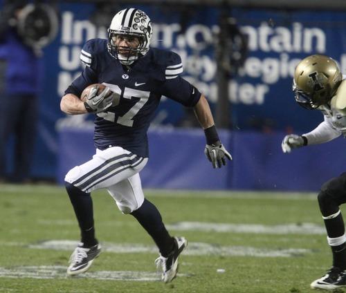 Rick Egan  | The Salt Lake Tribune  Brigham Young Cougars running back David Foote (27) runs the ball vs. the Idaho Vandals at Lavell Edwards Stadium Saturday.