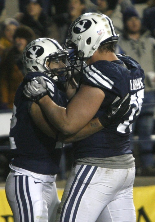 Rick Egan    The Salt Lake Tribune   Brigham Young Cougars running back Michael Alisa (42)(left) is congratulated  by offensive linesman Braden Brown (75)after Alisa scored another  BYU touchdown, in football action, BYU vs. the Idaho Vandals football game at Lavell Edwards Stadium, Saturday, November 12, 2011.