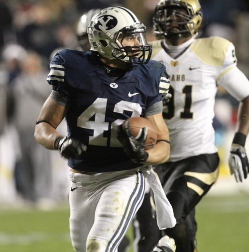 Rick Egan    The Salt Lake Tribune   Brigham Young Cougars running back Michael Alisa (42) looks back as he enters the endzone, for a BYU touchdown, in football action, BYU vs. the Idaho Vandals football game at Lavell Edwards Stadium, Saturday, November 12, 2011.