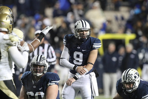 Rick Egan    The Salt Lake Tribune  Cougars quarterback Jake Heaps (9) runs the offense for BYU  in football action against the Idaho Vandals at Lavell Edwards Stadium Saturday.