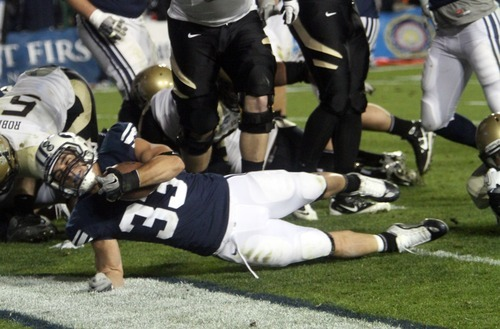 Rick Egan  | The Salt Lake Tribune   Brigham Young Cougars running back Bryan Kariya (33) dives into the endzone for a BYU touchdosn, in football action, BYU vs. the Idaho Vandals football game at Lavell Edwards Stadium, Saturday, November 12, 2011.