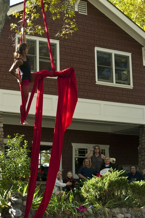 Chris Detrick  |  The Salt Lake Tribune With family and friends by his side, Brooke Hopkins watches as Aerial Arts of Utah member Deborah Eppstein performs at Hopkins' home in the Avenues Wednesday October 19, 2011.