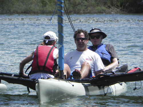 Brooke Hopkins (in the blue vest), paralyzed in a bike accident in 2008, goes sailing with his doctor, Jeffrey Rosenbluth. Courtesy Tanja Kari