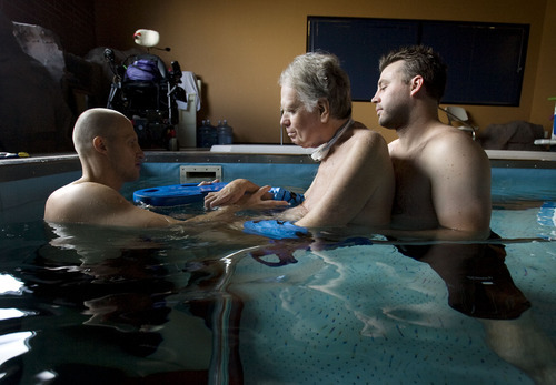 Steve Griffin  |  The Salt Lake Tribune   Physical therapist Matt Hansen, left, and LMT/PT Aide Mike Erickson , right, work with Brooke Hopkins, who was paralyzed from a bicycle accident three years ago, during pool therapy at Neuroworx in South Jordan, Utah Friday, November 11, 2011.