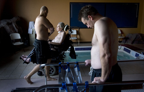 Steve Griffin  |  The Salt Lake Tribune   Brooke Hopkins, who was paralyzed from a bicycle accident three years ago, waits as physical therapist Matt Hansen, left, and LMT/PT Aide Mike Erickson prepare the therapy pool at Neuroworx in South Jordan, Utah Friday, November 11, 2011.