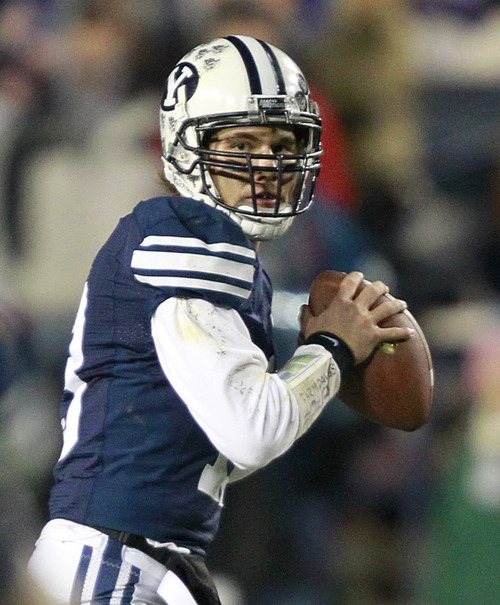 BYU quarterback Riley Nelson looks to throw a pass against Idaho during the first half of an NCAA college football game at LaVell Edwards Stadium, Saturday, Nov. 12, 2011, in Provo. Nelson left the game in the first quarter with an injury. (AP Photo/George Frey)