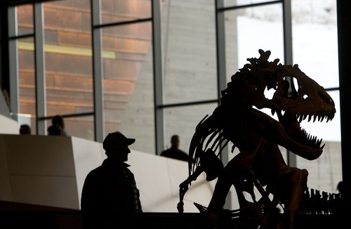 Steve Griffin  |  The Salt Lake Tribune   People get a close look at the dinosaur skeletons in the new Natural History Museum of Utah in Salt Lake City, Utah Saturday, November 5, 2011.