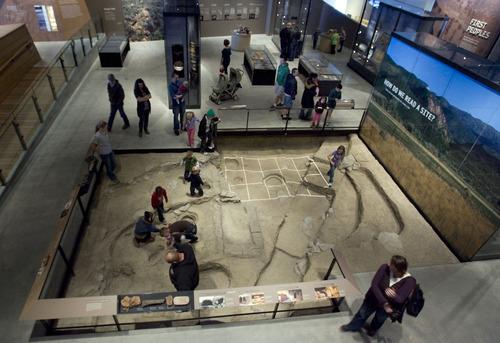 Steve Griffin  |  The Salt Lake Tribune   People walk through a replica of an archeological dig site at  the new Natural History Museum of Utah in Salt Lake City, Utah Saturday, November 5, 2011.