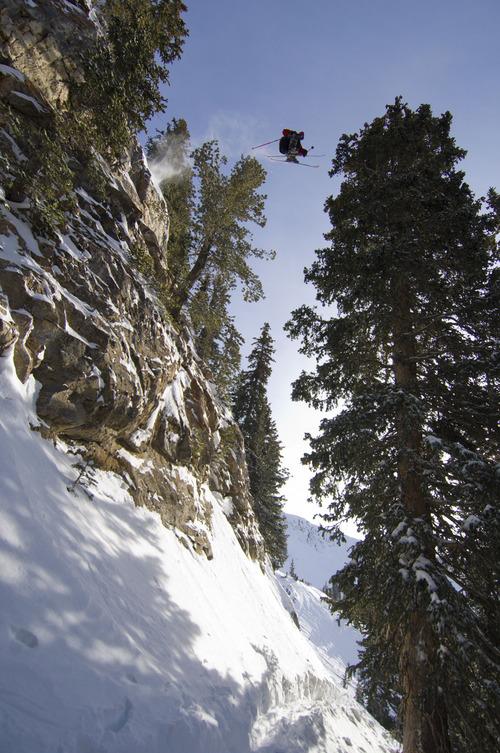 Jamie Pierre making a cliff jump at Snowbird, Utah. Courtesy Scott Markewitz