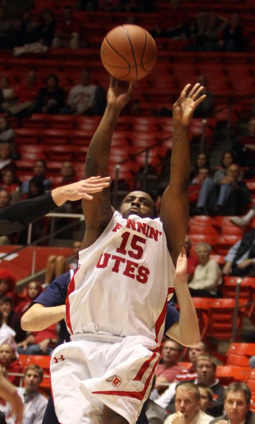 Rick Egan  | The Salt Lake Tribune   Utah guard Josh Watkins (15) shoots for Utah, in basketball action, Utah vs. San Diego Christian College, at the Huntsman Center, Monday, November 14, 2011.